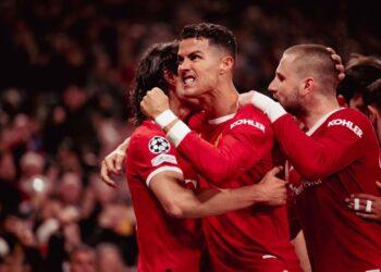 CRISTIANO Ronaldo (kiri) meraikan gol kemenangan Manchester United ketika menentang Atalanta di Old Trafford semalam.